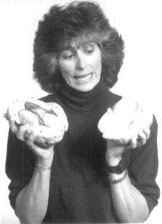 Debi Peterson looking quizzically at the 2 parts of the brain – which does not function well separated – CLICK TO EMAIL